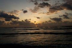 Ocean Sunrise. Beautiful Cloudy Sunrise over Indian Ocean Water's Edge outdoors Stock Image