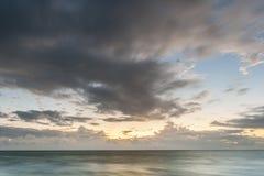 Ocean sunrise. Sunrise at ocean beautiful sunlight blue sky and clouds Royalty Free Stock Photo