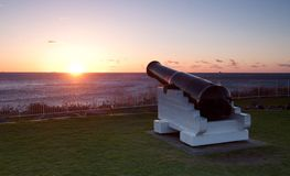 Ocean sunrise and cannons at wollongong. Sunrise over the ocean and cannons at wollongong Stock Photos