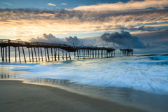 Ocean Sunrise Frisco Pier North Carolina Hatteras. Ocean sunrise over the damaged Frisco Pier on the Outer Banks of Cape Hatteras National Seashore in North Royalty Free Stock Photos