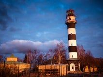 Ocean sunrise with lighthouse Stock Photo