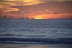 The sunrise peaks over the ocean horizon off the Amelia Island coastline. The ocean sunrise is never the same from day to day when it rises off the Amelia Island royalty free stock photography