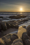 Ocean sunrise with rocks. Sunrise at the ocean with rocks. Punta del Diablo, Uruguay Royalty Free Stock Photos