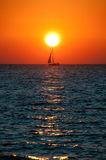 Ocean Sunset. Sunset colors over the ocean sea sail boat Stock Photos