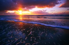 Ocean and sunset. On the beach at night royalty free stock image