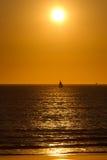 Ocean Sunset. Sailboat sailing through a Pacific Ocean Sunset stock photos