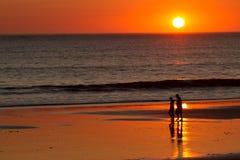 Ocean Sunset. People walking through a Pacific Ocean Sunset royalty free stock photos