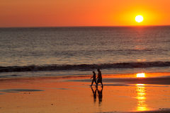 Ocean Sunset. People walking through a Pacific Ocean Sunset stock photography
