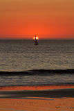 Ocean Sunset. Sailboat sailing through a Pacific Ocean Sunset Royalty Free Stock Images