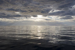 Ocean sunset. Ethereal ocean sunset, reflections on water, like mercury royalty free stock image