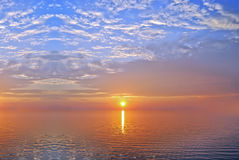 Ocean sunset background image. Beautiful landscape of sky and water at Sunset Stock Photo