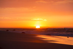 Ocean sunset on the beach and the Pacific Ocean in Mancora, Peru Royalty Free Stock Images