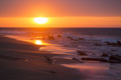 Ocean sunset on the beach and the Pacific Ocean in Punta Sal, Pe Stock Image