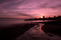 Ocean Sunset, Beach and Piers Royalty Free Stock Images