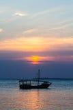 Ocean Sunset. Beautiful Indian Ocean sunset with a boat in silhouette. Zanzibar, Tanzania royalty free stock photo