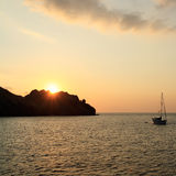 Ocean Sunset with Boat Royalty Free Stock Image