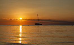 Ocean sunset with boat Royalty Free Stock Photo