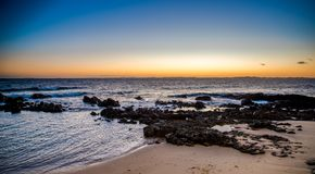 Ocean and the sunset. Forte Santa Maria in Bahia, Salvador - Brazil and some people fishing stock photos