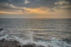 Ocean Sunset Kona Hawaii. Landscape of an ocean sunset with waves crashing on the rocks below, Kona, Hawaii Stock Photos