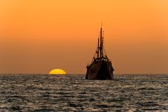 Ocean Sunset Ship Silhouette royalty free stock image