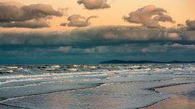 Ocean sunset before storm. Dramatic sky. Filtered Image Stock Image