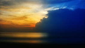 Ocean sunset. The sun is setting behind the cloud over the ocean. Timelapse FullHD 1080p stock footage