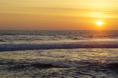 Ocean sunset. Surfers  are waiting for the wave on the sunset Stock Photography