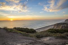 Ocean sunset view from the high bluffs stock photo