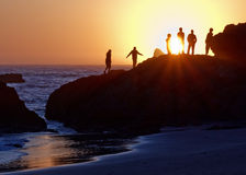 Ocean Sunset Watchers Stock Photo
