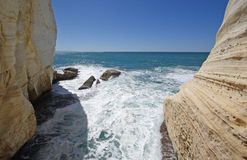 Ocean surf and cliffs. Ocean surf in between two cliff walls Royalty Free Stock Photo