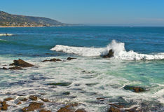 Ocean Surf, Laguna Beach California. Waves from a high surf hit the rocky shoreline  in the coastal city of Laguna Beach, southern California, on the Pacific Stock Photos