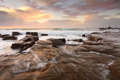 Ocean surf and overflows at sunrise Stock Photography