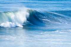 Ocean Surf and Waves. Blue ocean and surf with waves on bright, sunny day Stock Photo