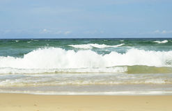 Ocean surf waves and white sandy beach summer background Stock Photos