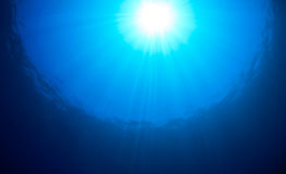 Ocean Surface Sunburst. Sunburst over the ocean surface on a tropical coral reef Royalty Free Stock Images