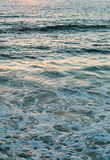 Ocean surface at the sunset on the coast Royalty Free Stock Photo