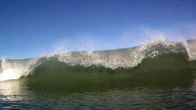 Ocean Surfing Waves Breaks Over the Camera in Hawaii. A series of ocean waves breaking near the shore on the island of Oahu, in Hawaii, USA stock video