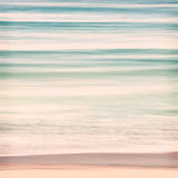 Ocean Swells. An abstract ocean seascape with blurred panning motion.  Image displays soft pastel colors with subtle cross-processing Stock Photos