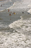Ocean Swimmers. Swimmers at Folly Beach near Charleston, SC jumping in the waves Stock Image