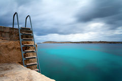 Ocean Swimming Pool. Long exposure of ladder on the Mediterranean sea royalty free stock photography