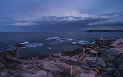 Rock swimming pool at sunrise Stock Photography