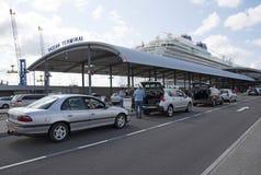 Ocean Terminal passengers and cruise ship Southampton UK. Cruise ship alongside Ocean terminal and passengers arriving Southampton UK Stock Photos