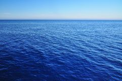 Ocean texture. Blue ocean texture with horizon and sky stock image