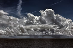 Ocean Thunderstorm with Cumulonimbus Clouds and Rain Stock Photo