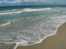 Ocean Tide Coming In. Tide coming in at the beach Stock Photos