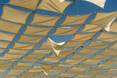 Shade cloths in the Plaza in Santa Cruz Huatulco Mexico. Huatulco is a resort region in the Mexican state of Oaxaca with white Pacific coast beaches. The royalty free stock photography