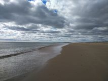 White clouds above the beach royalty free stock photo