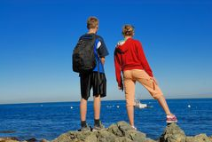 Ocean trip. Siblings on a trip by the sea Royalty Free Stock Photo
