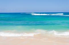 Ocean and tropical sandy beach background. (Hawaii, Kauai Stock Photography