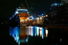 Ocean tug  on the dock. Completion of the  ocean tug in the Gdansk  Ship Repair Yard Stock Images